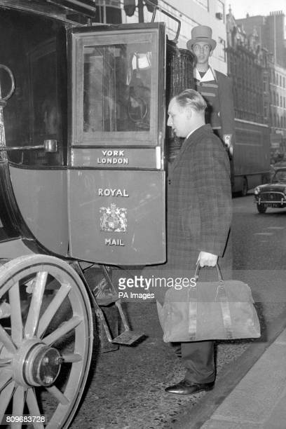 The old London to Bristol mail coach in London before its journey to Battersea Heliport The coach drawn by four horses is taking part in a restage of...
