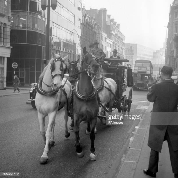 The old London to Bristol mail coach runs through London on it's way to Battersea Heliport The coach drawn by four horses is taking part in a restage...