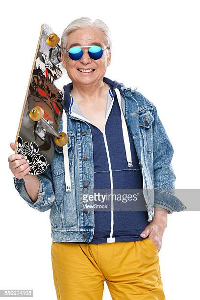 The old man carrying a skateboard fashion