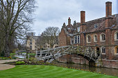 The old mathematical bridge in Cambridge, England with cloudy sky