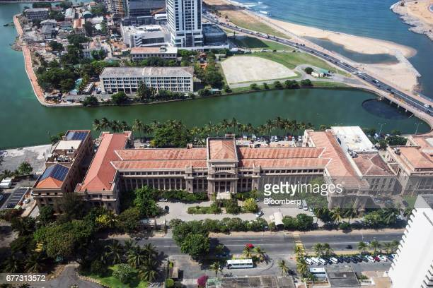 The Old Parliament Building bottom which houses the the Presidential Secretariat stands in Colombo Sri Lanka on Friday April 21 2017 Once fought over...