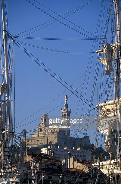 The 'Old Port' viewed against the backdrop of the 'Notre Dame de la Garde' basilica with the three masts of the 'Belem' sailing ship in the foreground