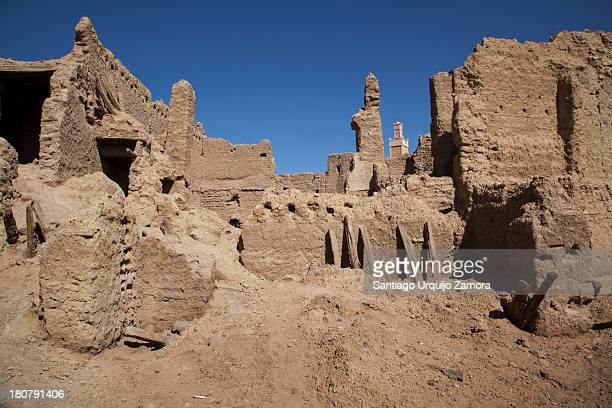 CONTENT] The old ruins of ksar Haman Tahtani in the oasis town of Figuig Oriental Region Morocco with a new mosque towering over them on the...