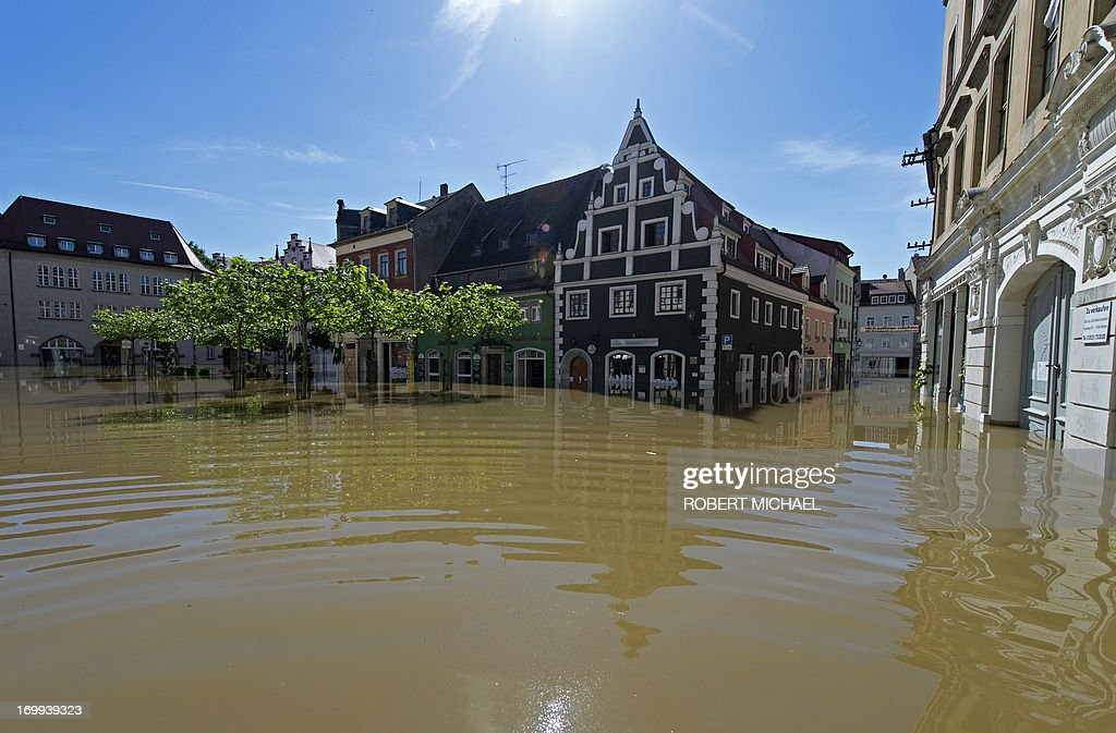 The old town is flooded by the river Elbe in Meissen, eastern Germany, on June 5, 2013. Chancellor Angela Merkel pledged 100 million euros in emergency aid for flood-ravaged areas as surging waters that have claimed at least 11 lives and forced tens of thousands of evacuations across central Europe bore down on eastern Germany.