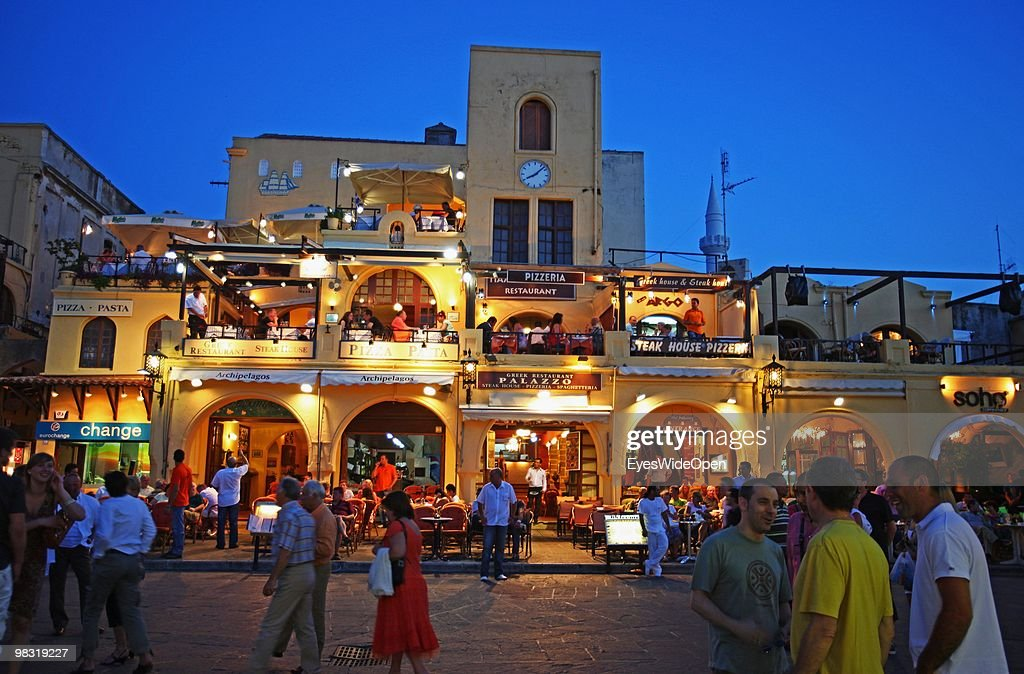 The Old town of Rhodes city with restaurants and shops on July 16 2009 in Rhodes Greece Rhodes is the largest of the Greek Dodecanes Islands