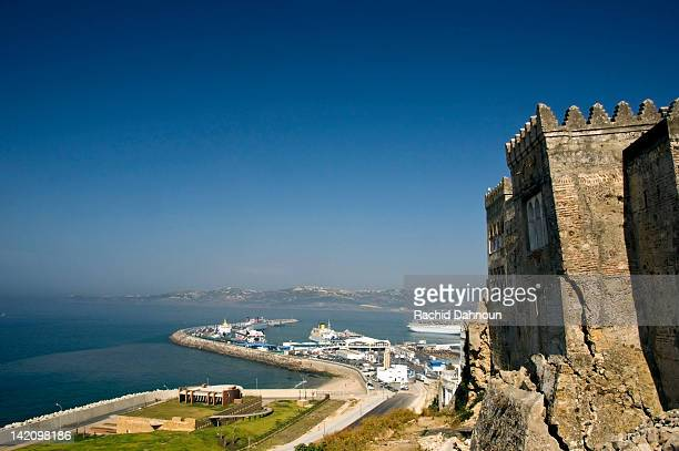 The old walls of the Tangier Kasbah perched above the new modern Port of Tangier, Morocco.