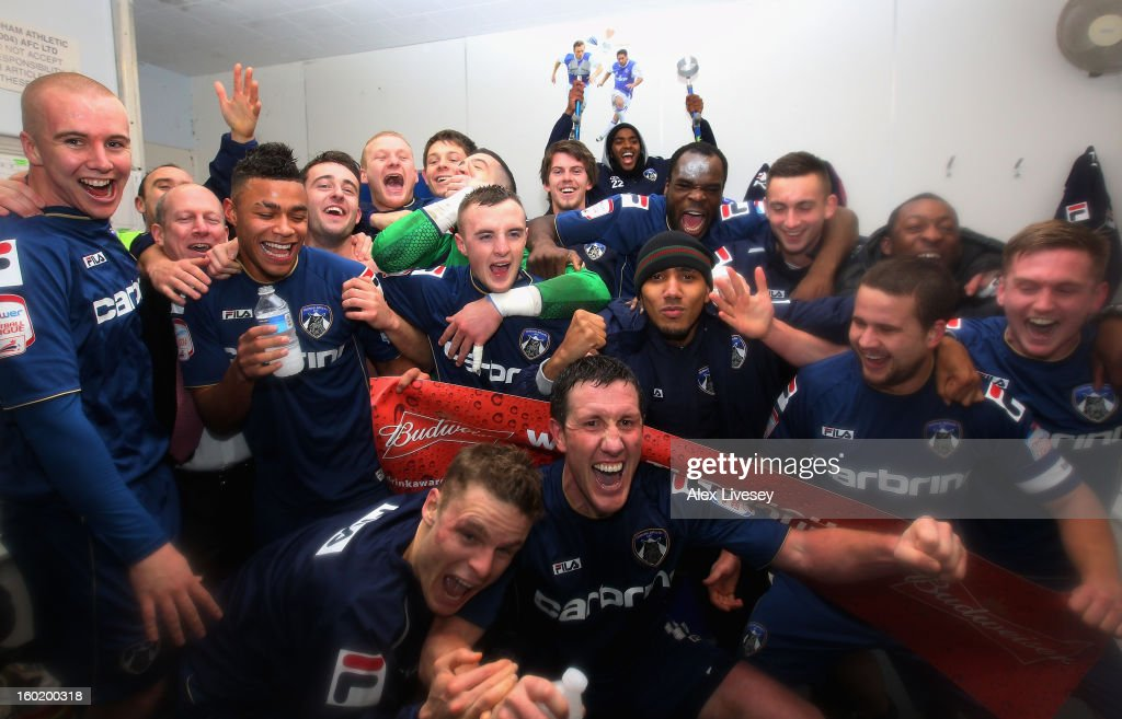 The Oldham players celebrate victory at the end of the FA Cup with Budweiser Fourth Round match between Oldham Athletic and Liverpool at Boundary Park on January 27, 2013 in Oldham, England.