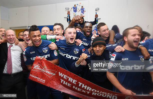 The Oldham players celebrate victory at the end of the FA Cup with Budweiser Fourth Round match between Oldham Athletic and Liverpool at Boundary...