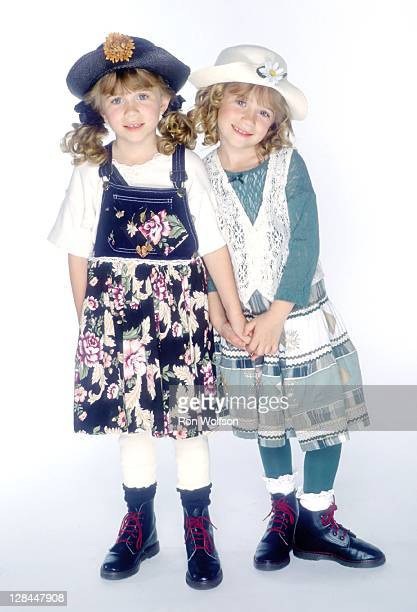 The Olsen Twins pose for a portrait during a private photo session on November 3 1994 at Center Staging Rehearsal Studios in Los Angeles California