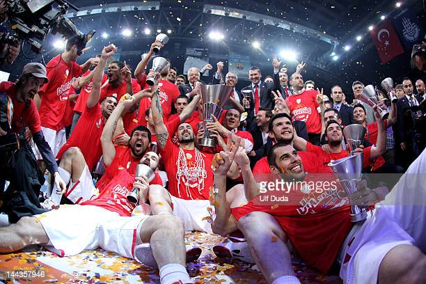 The Olympiacos Piraeus players and staff celebrate victory with the trophy at the end of the Turkish Airlines EuroLeague Final Four Final match...