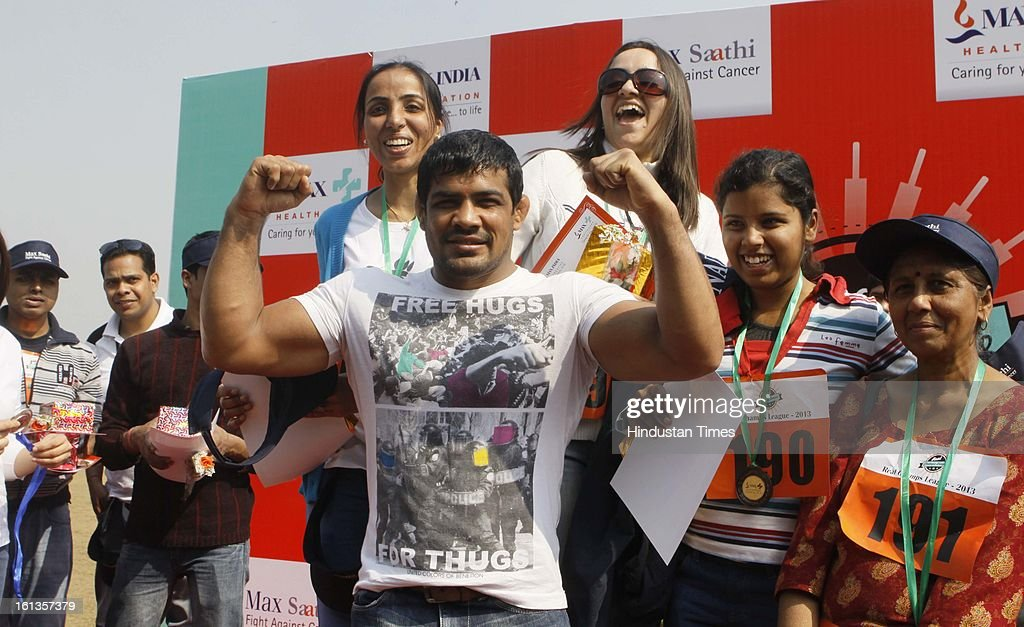 The Olympian Wrestler Sushil Kumar with the winners of the athletic meet during the 'Fight Against Cancer' program in which normal persons, cancer persons and their relative took part at Common Wealth Games Villager on February 10, 2013 in New Delhi, India.