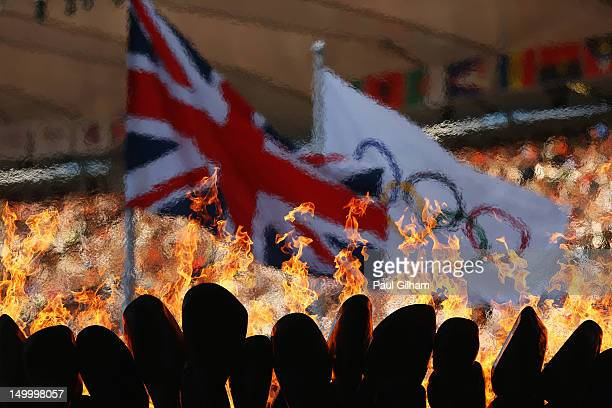 The Olympic Cauldron burns in front of the Union Jack and Olympic flag on Day 12 of the London 2012 Olympic Games at Olympic Stadium on August 8 2012...
