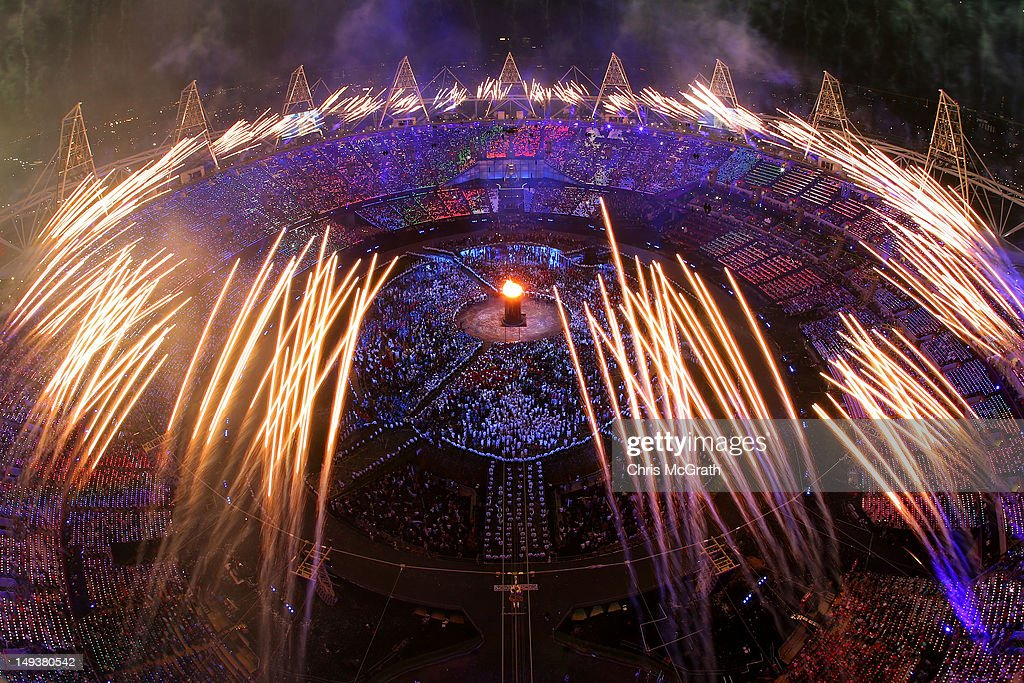 The Olympic Cauldron is lit as fireworks go of during the Opening Ceremony of the London 2012 Olympic Games at the Olympic Stadium on July 27, 2012 in London, England.