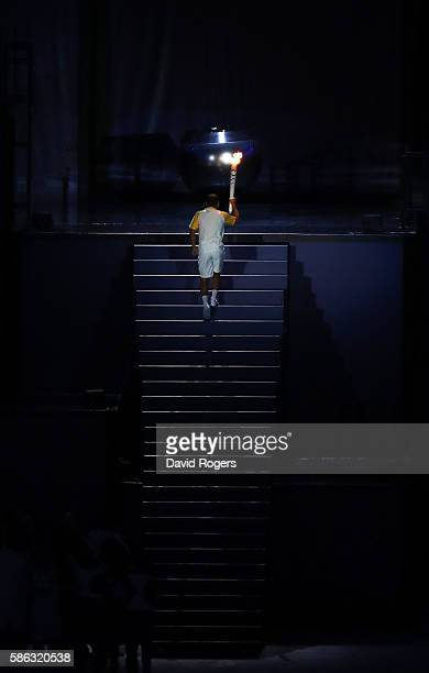 The Olympic Cauldron is lit by the final torch bearer Vanderlei Cordeiro de Lima during the Opening Ceremony of the Rio 2016 Olympic Games at...