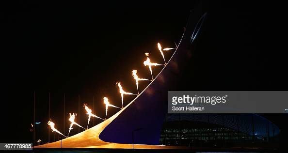 The Olympic Cauldron is lit over the Olympic Park during the Opening Ceremony of the Sochi 2014 Winter Olympics at Fisht Olympic Stadium on February...