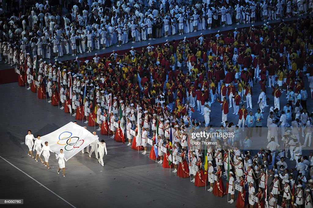 The Olympic Flag enters the stadium during the Opening Ceremony for the Beijing 2008 Olympic Games at the National Stadium on August 8 in Beijing...