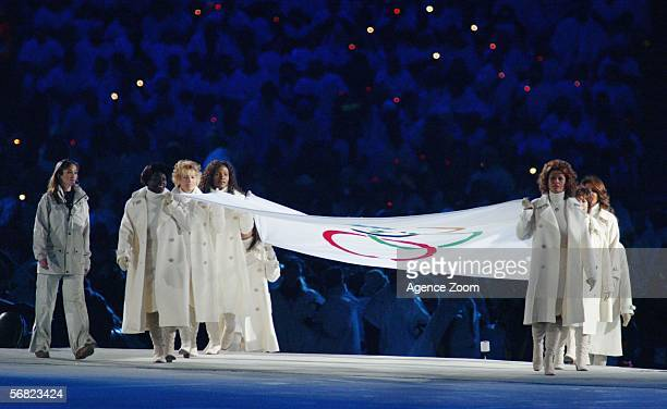 The Olympic flag is carried into the stadium during the Opening Ceremony of the Turin 2006 Winter Olympic Games on February 10 2006 at the Olympic...