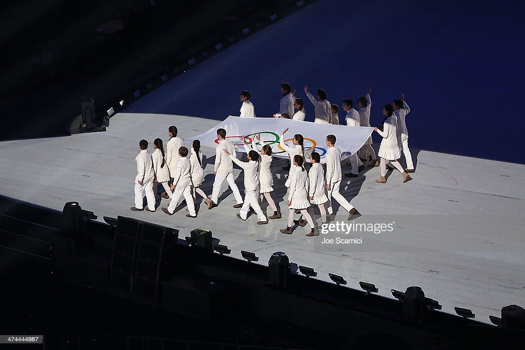 The Olympic Flag is carried out of the Fisht Stadium as part of the 2014 Sochi Winter Olympics Closing Ceremony at Fisht Olympic Stadium on February 23, 2014 in Sochi, Russia.