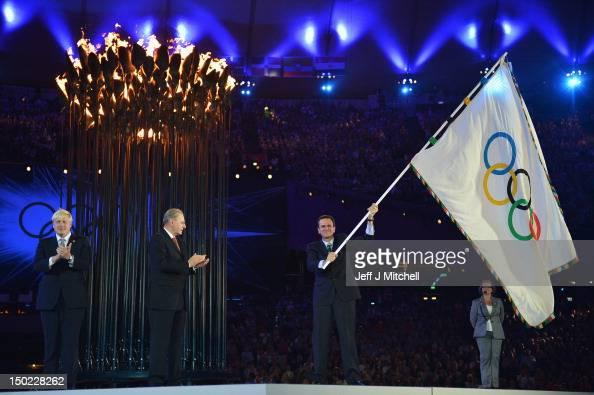 The Olympic Flag is handed from Mayor of London Boris Johnson to IOC President Jacques Rogge who passes to Mayor of Rio de Janeiro Eduardo Paes...