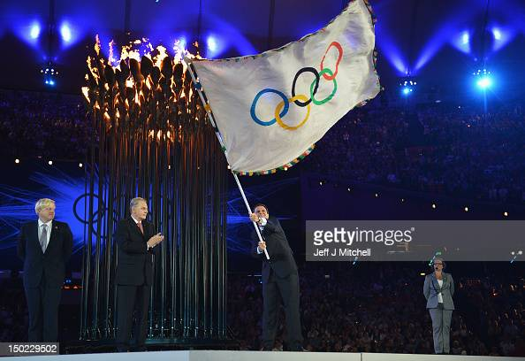 The Olympic Flag is handed from Mayor of London Boris Johnson to IOC President Jacques Rogge who passes it to Mayor of Rio de Janeiro Eduardo Paes...