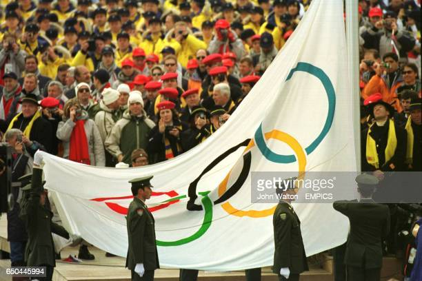 The Olympic flag is raised during the Opening Ceremony
