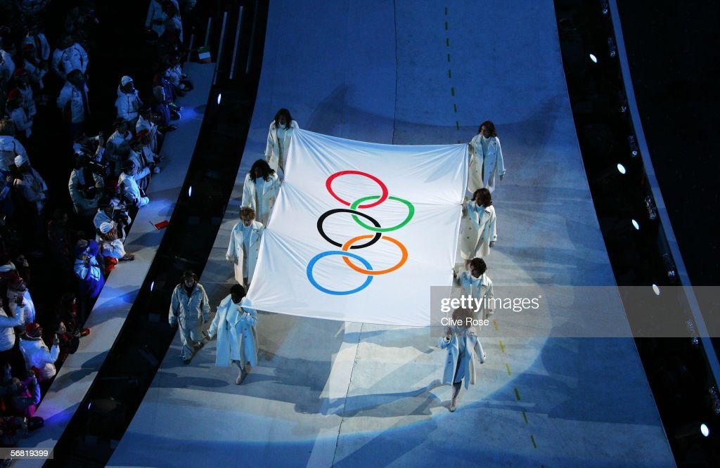 The Olympic flag is seen during the Opening Ceremony of the Turin 2006 Winter Olympic Games on February 10 2006 at the Olympic Stadium in Turin Italy
