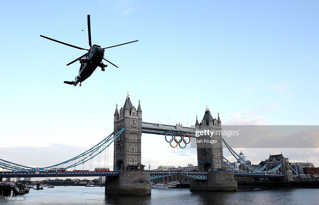 The Olympic flame arrives in London onboard a Sea King Helicopter during the London 2012 Olympic Torch Relay on July 20, 2012 in London, England. The Olympic Flame is now on day 63 of a 70-day relay involving 8,000 torchbearers covering 8,000 miles.