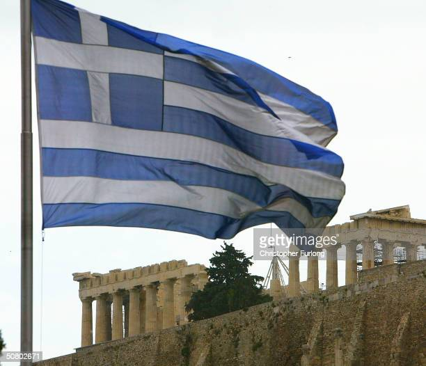 The Olympic flame burns against the backdrop of the Parthenon May 5 2004 in Athens Greece Security concerns were heightened after three bombs...