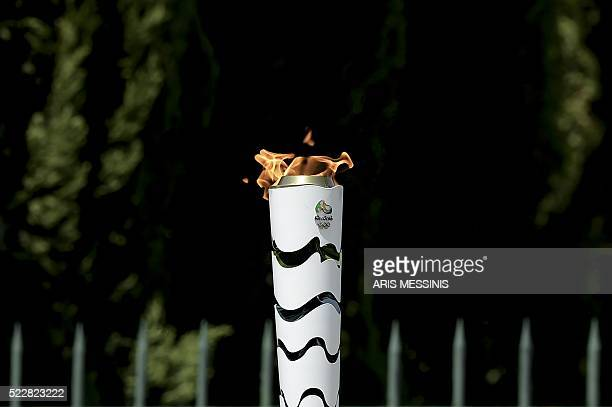 The Olympic Flame burns on a torch during the torch relay on April 21 qfter the lighting ceremony of the Olympic flame in ancient Olympia the...