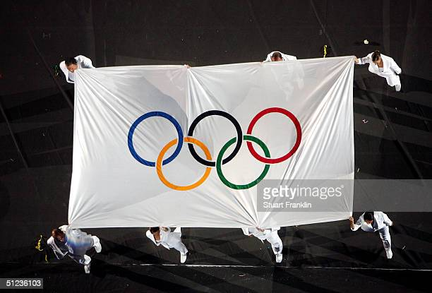 The Olympic flame is carried away during the closing ceremonies of the Athens 2004 Summer Olympic Games on August 29 2004 at the Sports Complex...