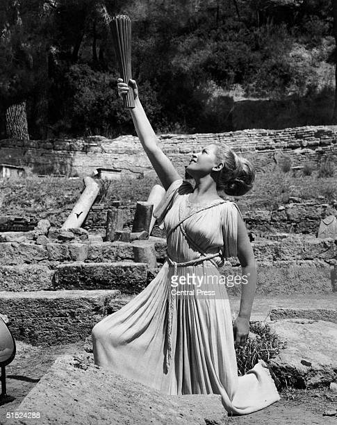 The Olympic Flame is held aloft by a 'High Priestess' at the ancient Greek city of Olympia from where it will be carried to Mexico City for the start...