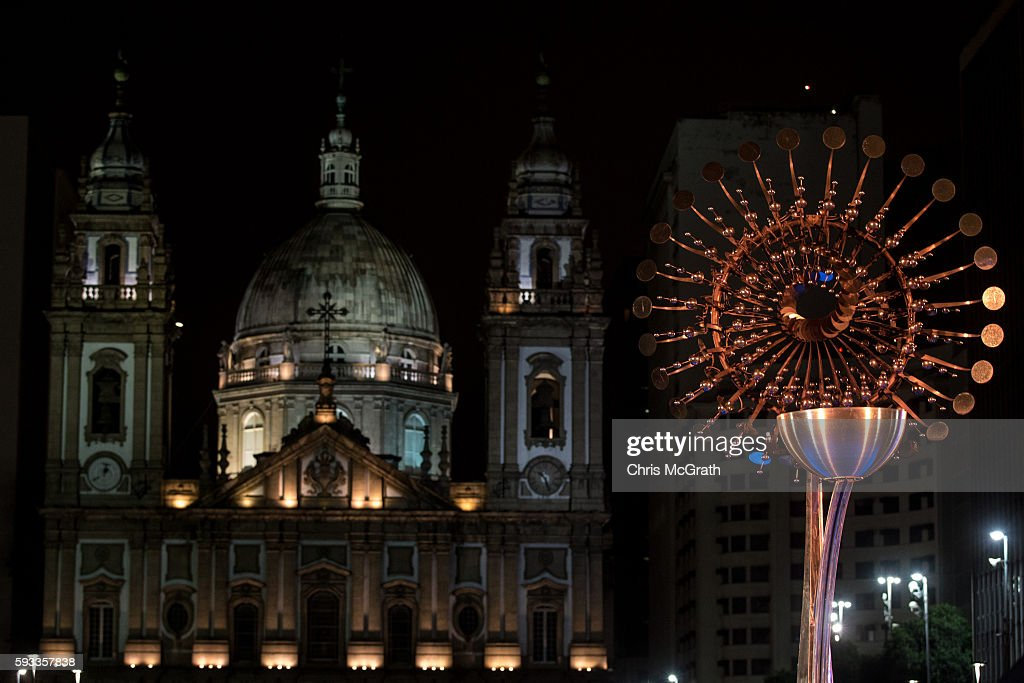 The Olympic flame is seen extinguished in front of the candelaria church on the Olympic Boulevard while the Rio 2016 closing ceremony takes place at...