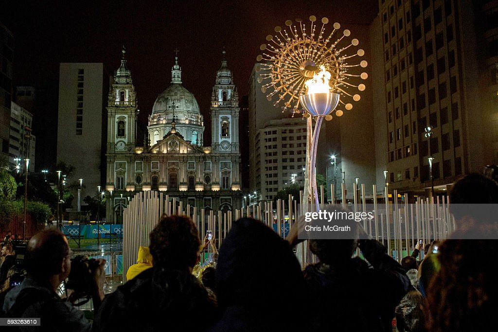 The Olympic flame is seen lit in front of the candelaria church on the Olympic Boulevard while the Rio 2016 closing ceremony takes place at Maracana...