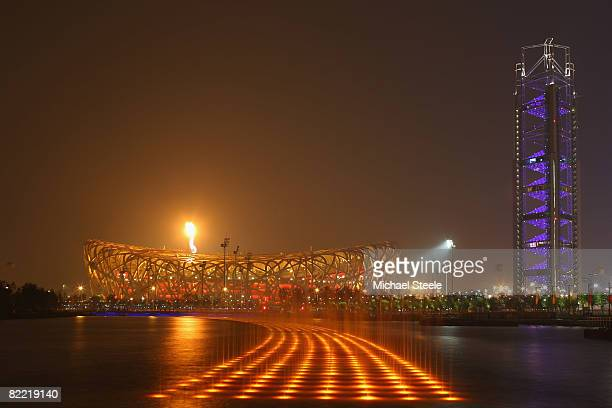The Olympic flame shines above the National Stadium during the Opening Ceremony for the 2008 Beijing Summer Olympics on August 8 2008 in Beijing China