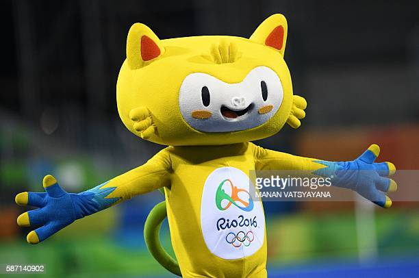 The Olympic mascot Vinicius walks onto the field in a break during the men's field hockey Australia vs Spain match of the Rio 2016 Olympics Games at...