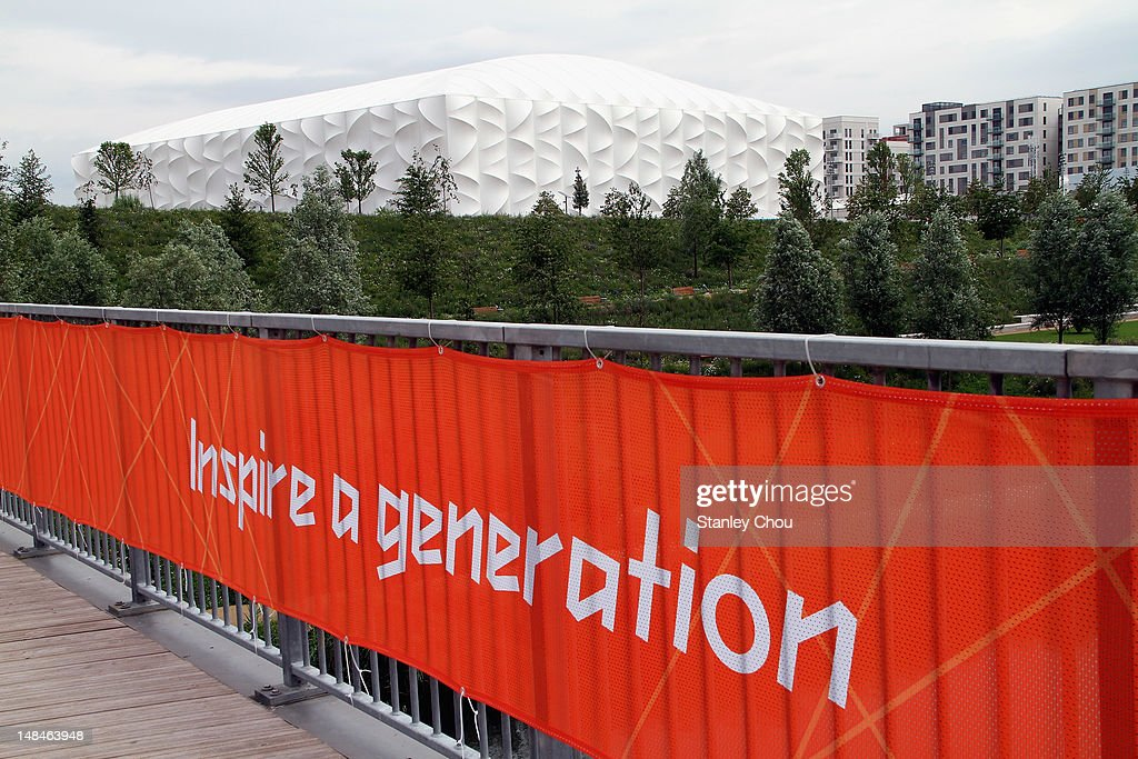 The Olympic motto foreground the Basketball Arena at the Olympic Park on July 17 2012 in London England