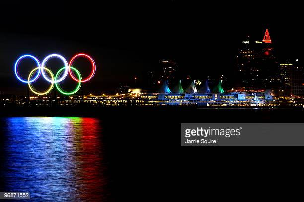 The Olympic rings and Canada Place are seen in front of downtown Vancouver during the early morning on day 8 of the Vancouver 2010 Winter Olympics on...