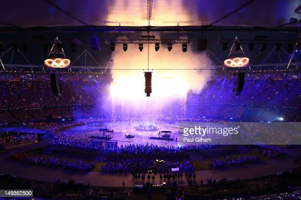 The Olympic rings are assembled above the stadium in a scene depicting the Industrial Revolution during the Opening Ceremony of the London 2012...