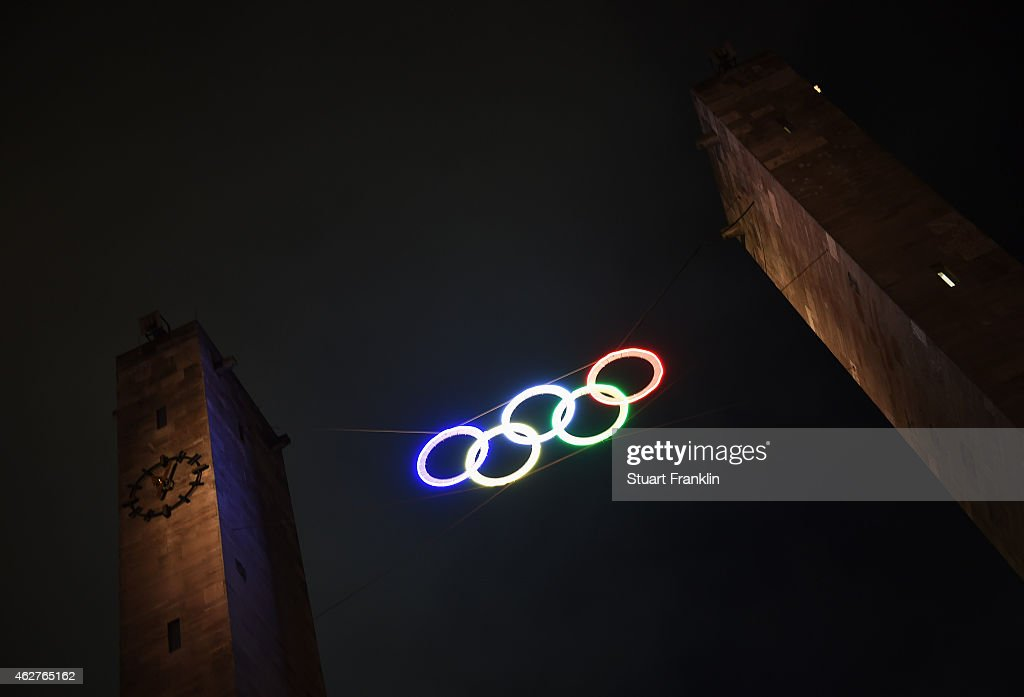 The Olympic rings are illuminate outside the Berlin Olympic stadium as a symbol of Berlins bid to host the 2024 summer Olympic games after the...