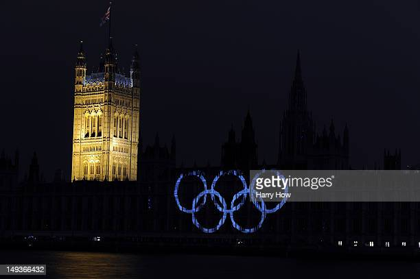 The Olympic rings are projected onto the House of Parliament to mark the start of the 2012 Olympic Games on July 27 2012 in London England
