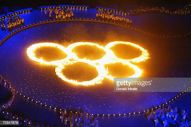 The Olympic Rings in flames during the Opening Ceremony of the Salt Lake City Winter Olympic Games on February 8 2002 at the RiceEccles Olympic...