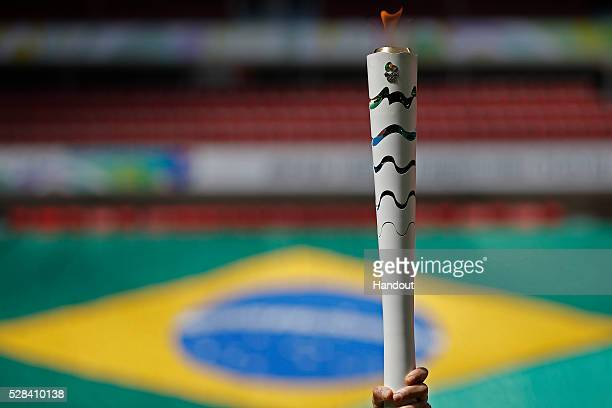 The Olympic Torch during the Olympic Flame torch relay at Mane Garrincha stadium on May 3 2016 in Brasilia Brazil The Olympic torch will pass through...