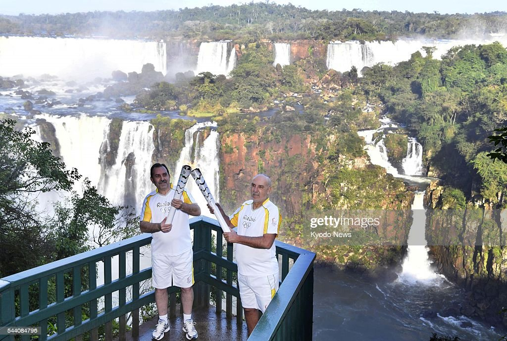 The Olympic torch for the Rio de Janeiro Summer Games arrives at the world famous Iguazu Falls on July 1, 2016. The Olympic torch will have been carried through 327 Brazilian cities by the time it arrives for the opening ceremony on Aug. 5.