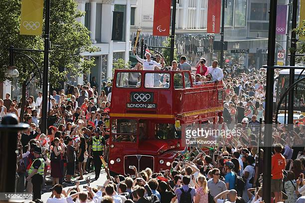 The Olympic Torch is carried on top of an open top bus down Oxford Street on July 26 2012 in London England The Olympic Flame is now on day 68 of a...