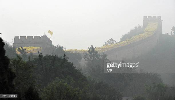 The Olympic torch is carried up a section of the Great Wall in Badaling outside Beijing on August 07 2008 a day before the 2008 Beijing Olympic Games...