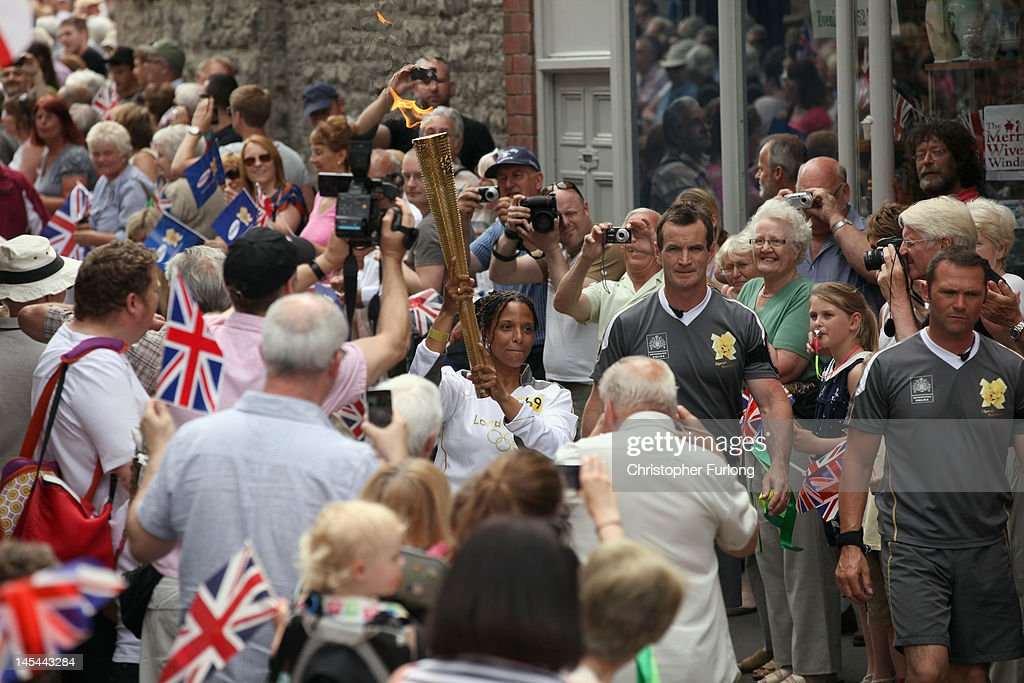 The Olympic Torch passes through Much Wenlock, birthplace and former home of William Penny Brookes the founding father of the modern Olympics on May 30, 2012 in Much Wenlock, England. The Shropshire town of Much Wenlock is the birthplace of William Penny Brookes the founding father of the modern Olympics. The first Wenlock Olympian games were held in 1850 for 'every grade of man' amongst the athletic events it even included knitting and academic studies such as writing and arithmetic. Wenlock, one of the London 2012 mascots is named in honour of the Shropshire town.