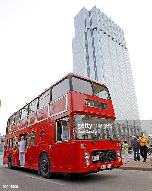 The Olympic Torch passes through the streets of London on a double decker bus during the Vancouver 2010 Olympic Torch Relay on December 24 2009 in...