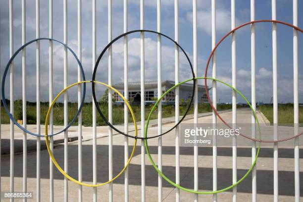 The Olympicring logo is displayed on a gate at the Morodok Techo National Sports Complex in Phnom Penh Cambodia on Tuesday Oct 24 2017 China's...