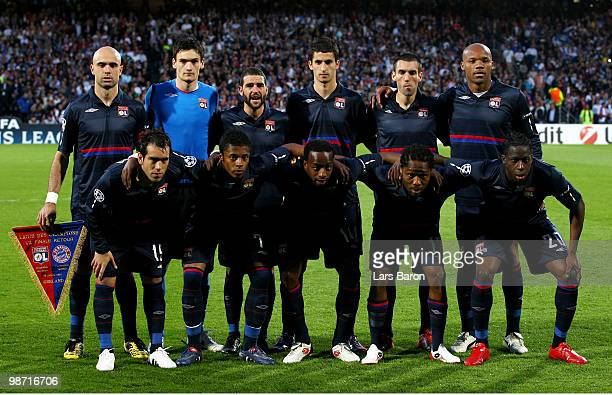 The Olympique Lyonnais team pose for the cameras prior to kickoff during the UEFA Champions League semi final second leg match between Olympique...
