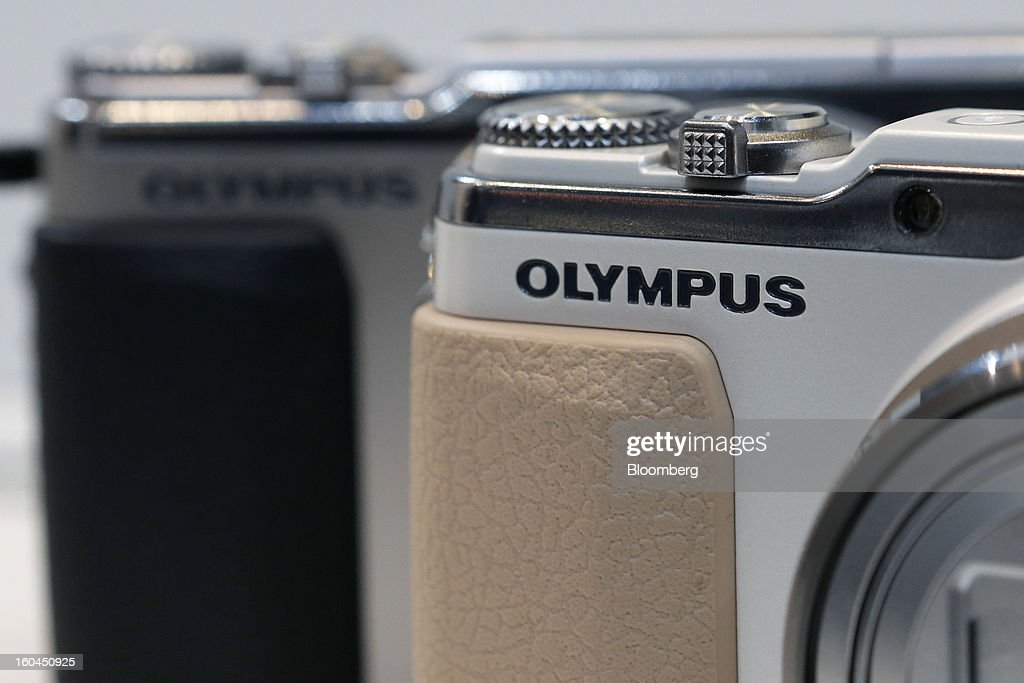 The Olympus Corp. logo is displayed on the company's Stylus compact digital cameras at the CP+ Camera and Photo Imaging Show in Yokohama City, Japan, on Thursday, Jan. 31, 2013. The CP+ Camera and Photo Imaging Show runs from Jan. 31 to Feb. 3. Photographer: Kiyoshi Ota/Bloomberg via Getty Images